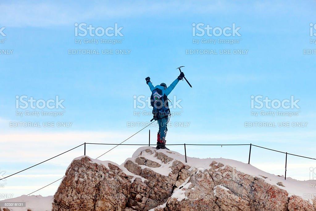 Polish Mountain Climber Raising Hands After Reaching Summit stock photo
