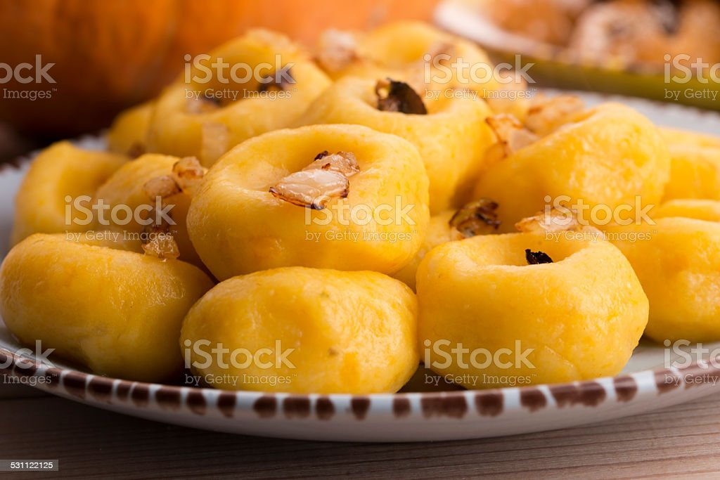 Polish noodles ( kluski slaskie ) with potatoe and pumpkin stock photo