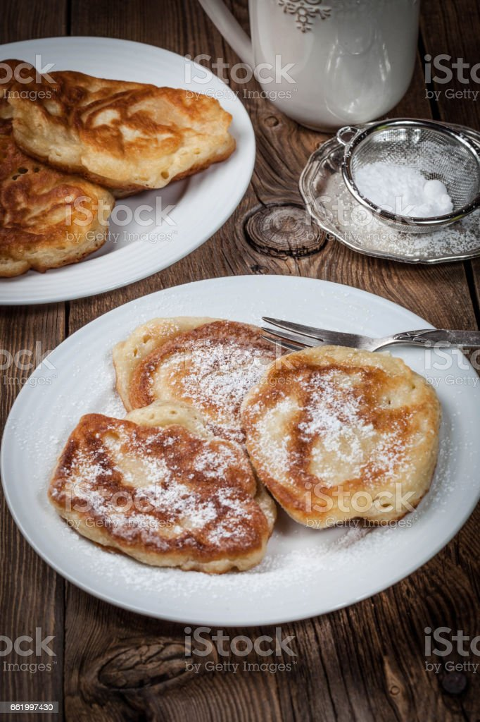 Polish pancakes with powdered sugar. royalty-free stock photo