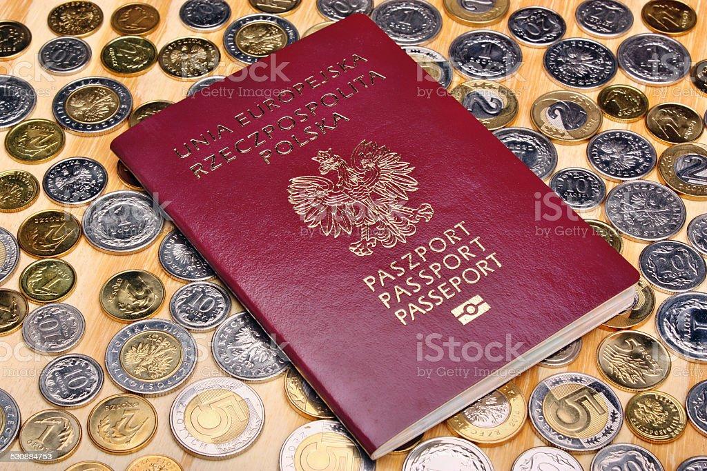 Polish passport and money coins stock photo