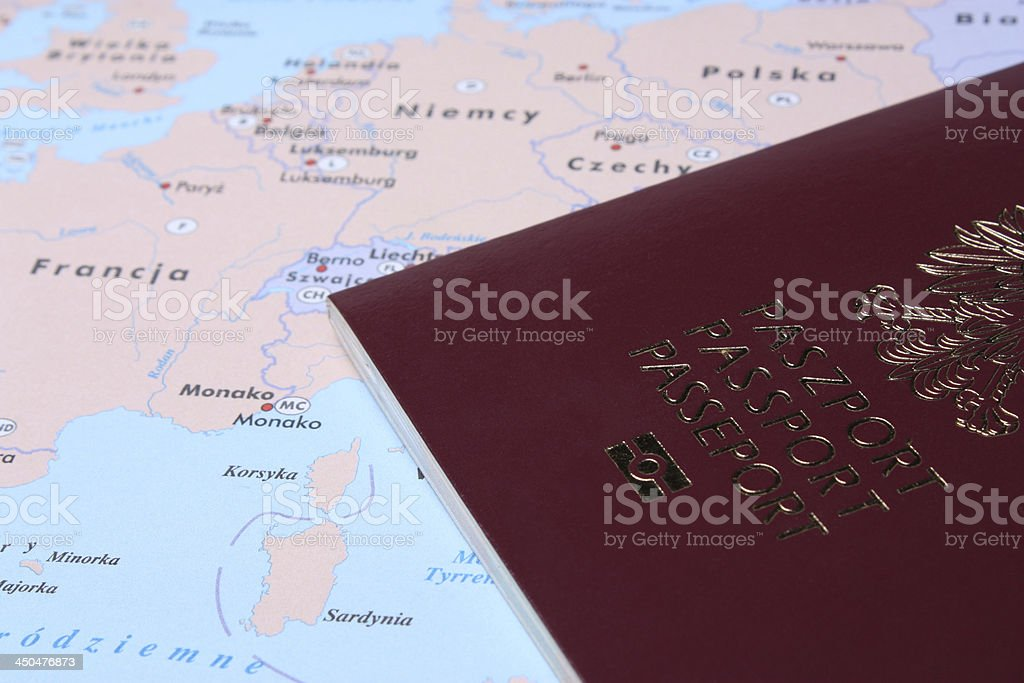 Polish Passport on a map stock photo