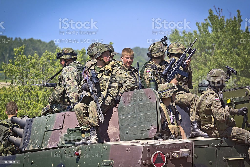 Polish Soldiers with military battlefield transport vehicle stock photo