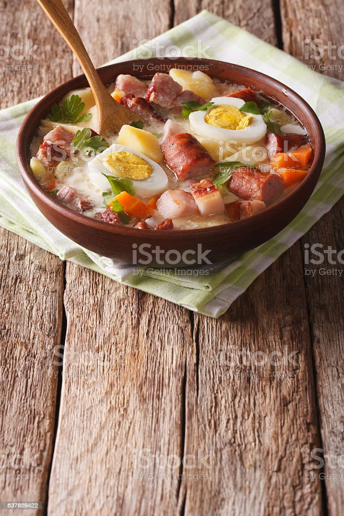 Polish Zurek soup with sausage, vegetables and eggs stock photo