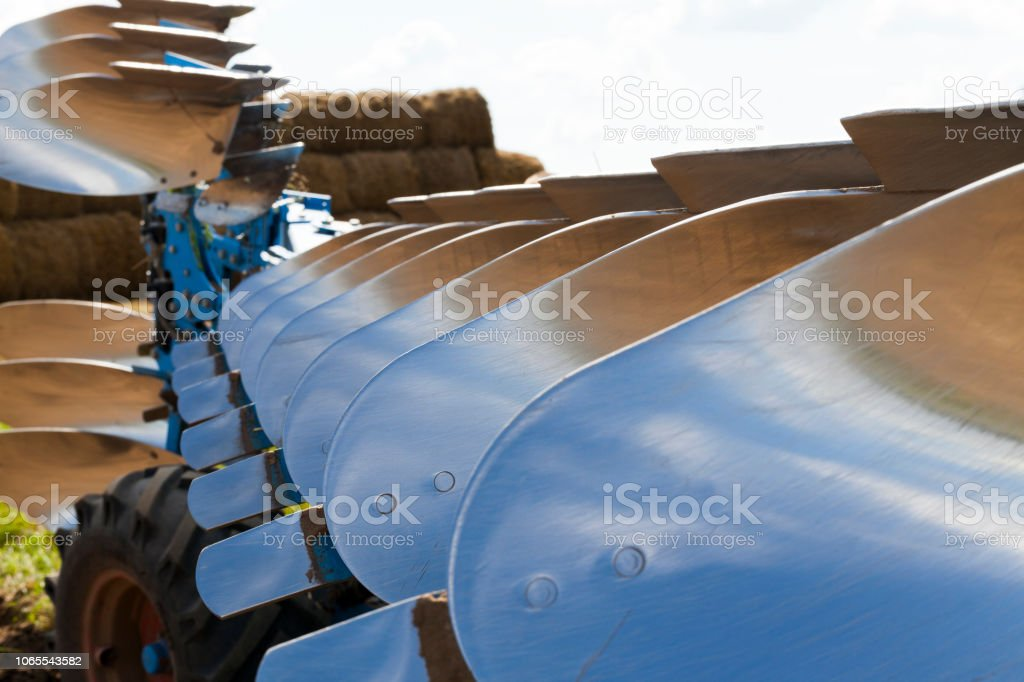 polished blade of the plow stock photo