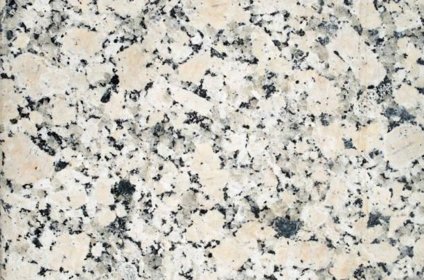 Polished granite for cladding slabs closeup stock photo