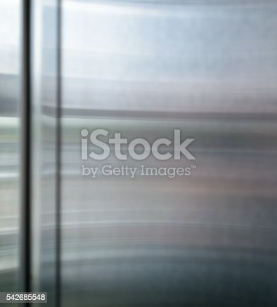 542685294istockphoto Polished shiny steel metal surface with multicolored reflections and glare 542685548