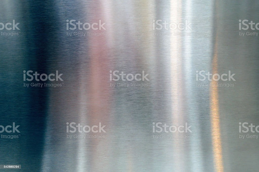 Polished shiny steel metal surface with reflections and glare stock photo