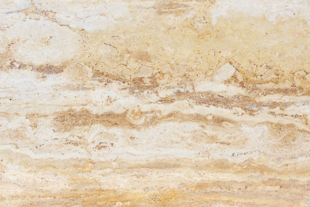 Polished surface of beautiful sand-colored Travertine. Background image, texture. stock photo