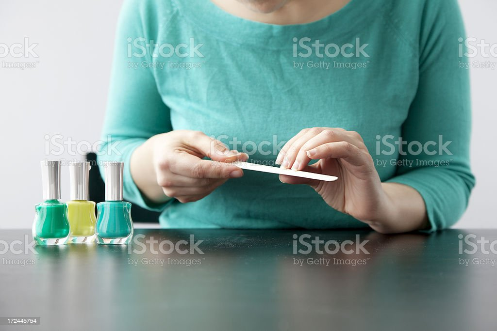 Polishing nails royalty-free stock photo