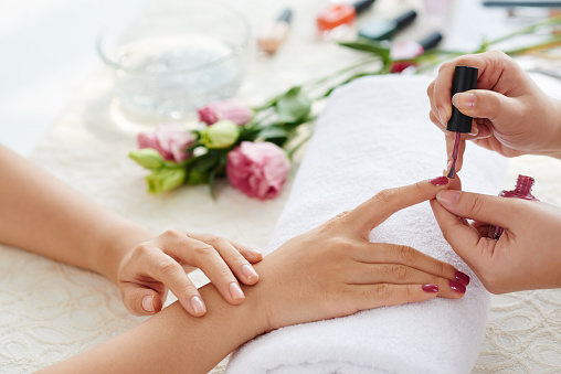 Polishing nails stock photo
