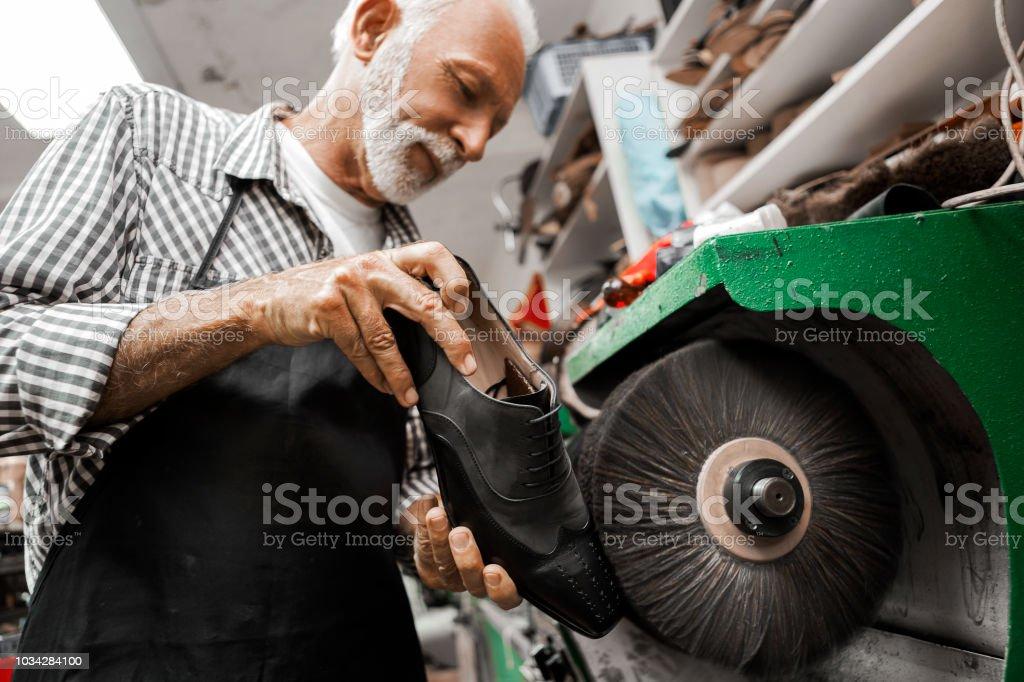 Polishing shoes on polishing machine stock photo