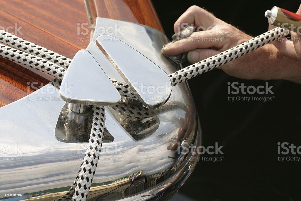 Polishing the bow stock photo