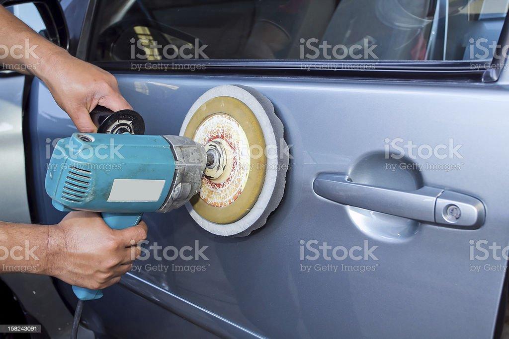 Polishing the car with power buffer machine royalty-free stock photo