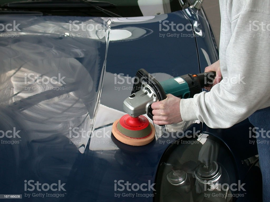 Polishing the hood royalty-free stock photo