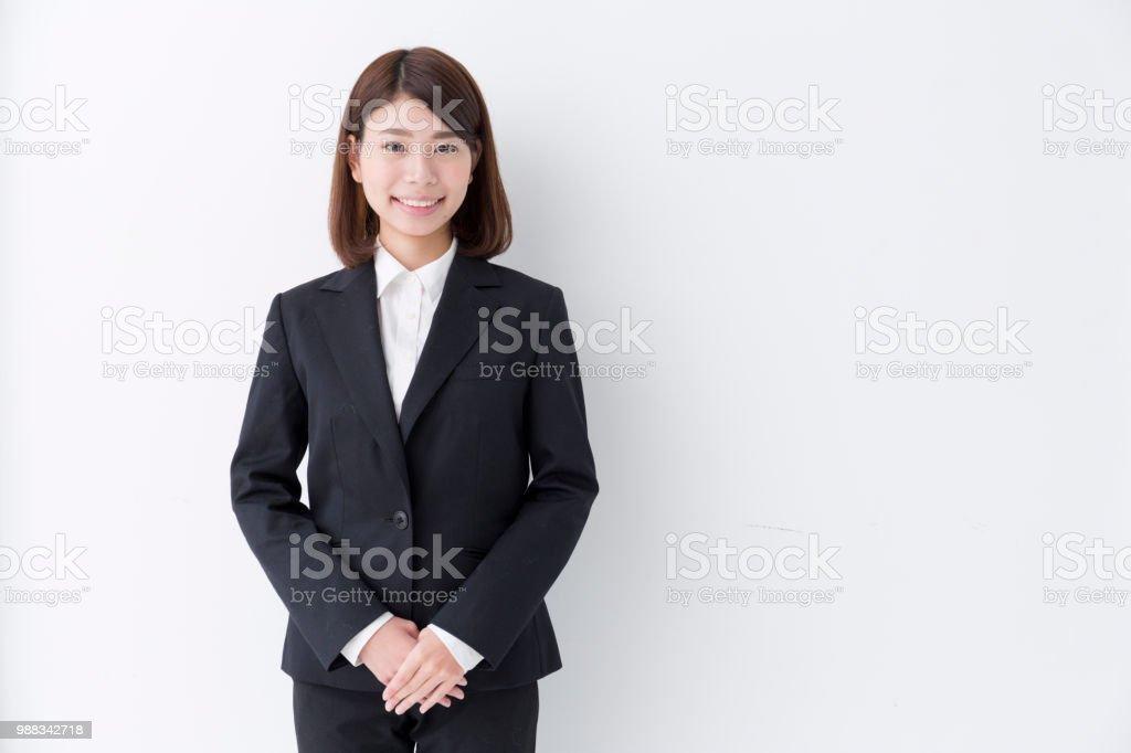 スーツで丁寧な若い女性 ストックフォト