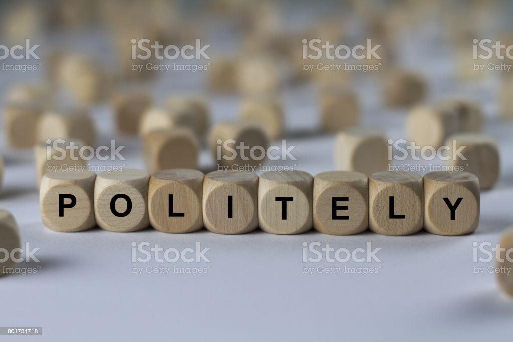 politely - cube with letters, sign with wooden cubes stock photo