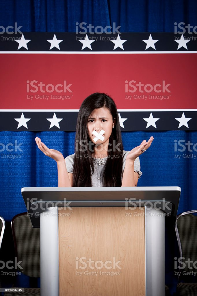 Political Censorship: Asian Girl at Podium royalty-free stock photo