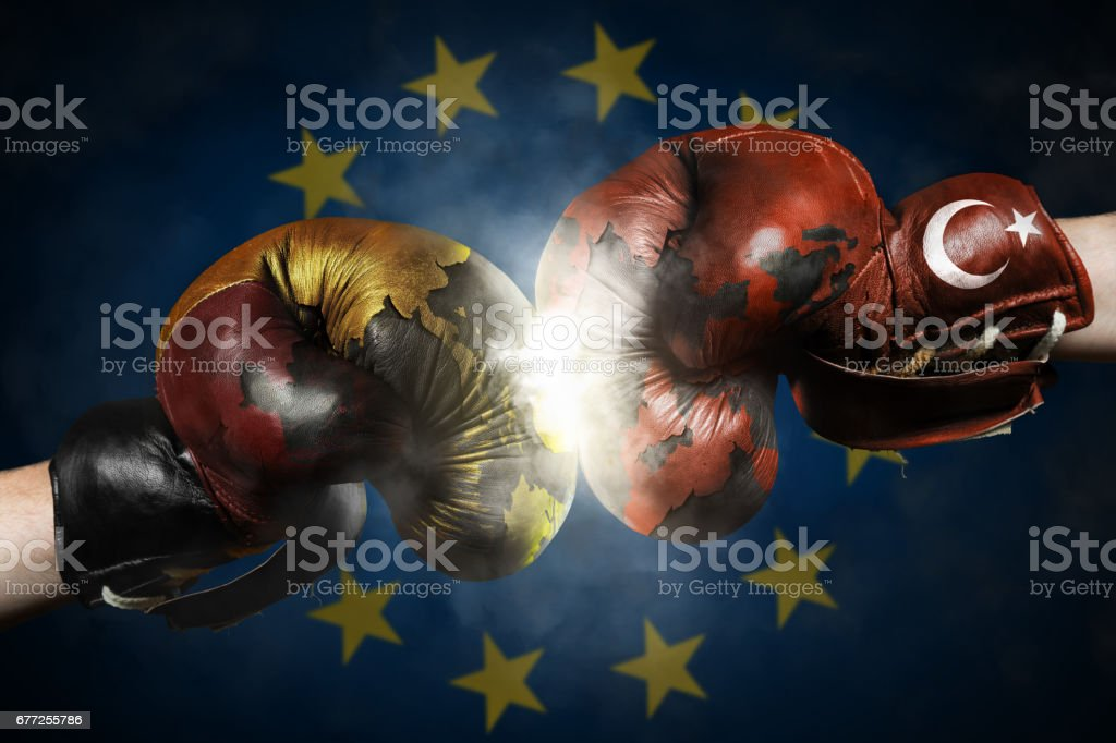 Political Crisis between the Germany and Turkey symbolized with Boxing Gloves stock photo
