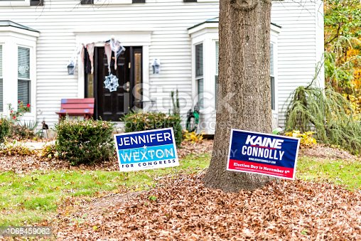 1157022917 istock photo Political Election sign for Democrat Congress woman Jennifer Wexton representative on lawn, Tim Kaine, Connolly in Virginia, Halloween decorations 1065459062