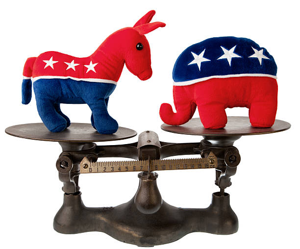 US political mascotts on antique scale stock photo