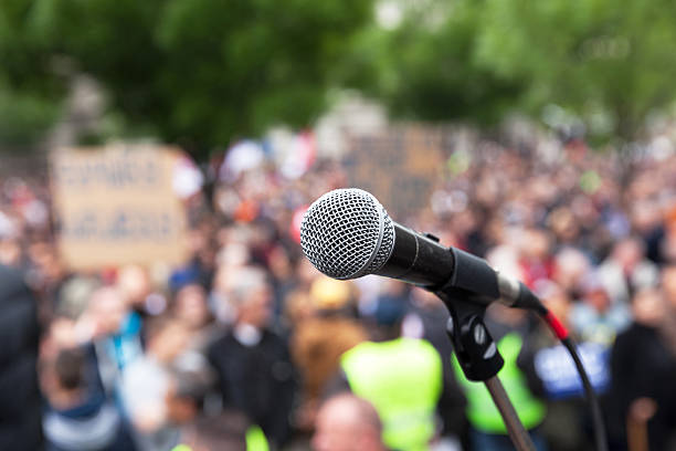 Political protest. Public demonstration. Microphone. stock photo