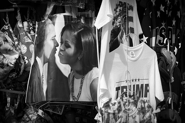 Political souvenirs for sale on sidewalk in Washington DC Washington DC, USA - July 2, 2016: A sidewalk vendor sells a variety of political and patriotic souvenirs in Washington DC barack obama stock pictures, royalty-free photos & images