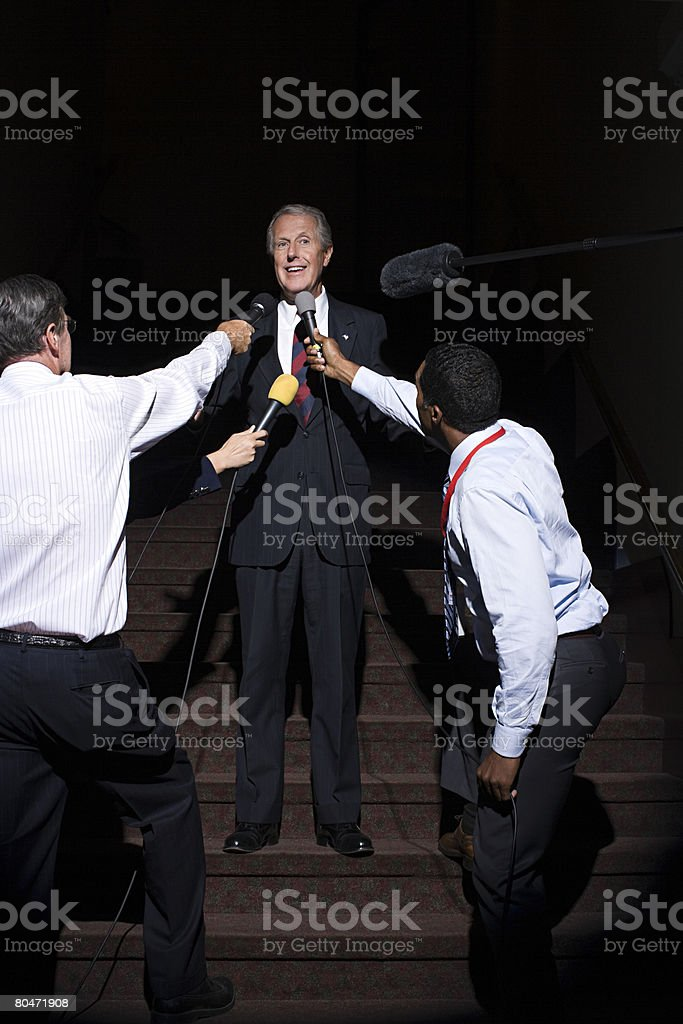 A politician being interviewed by reporters royalty-free stock photo
