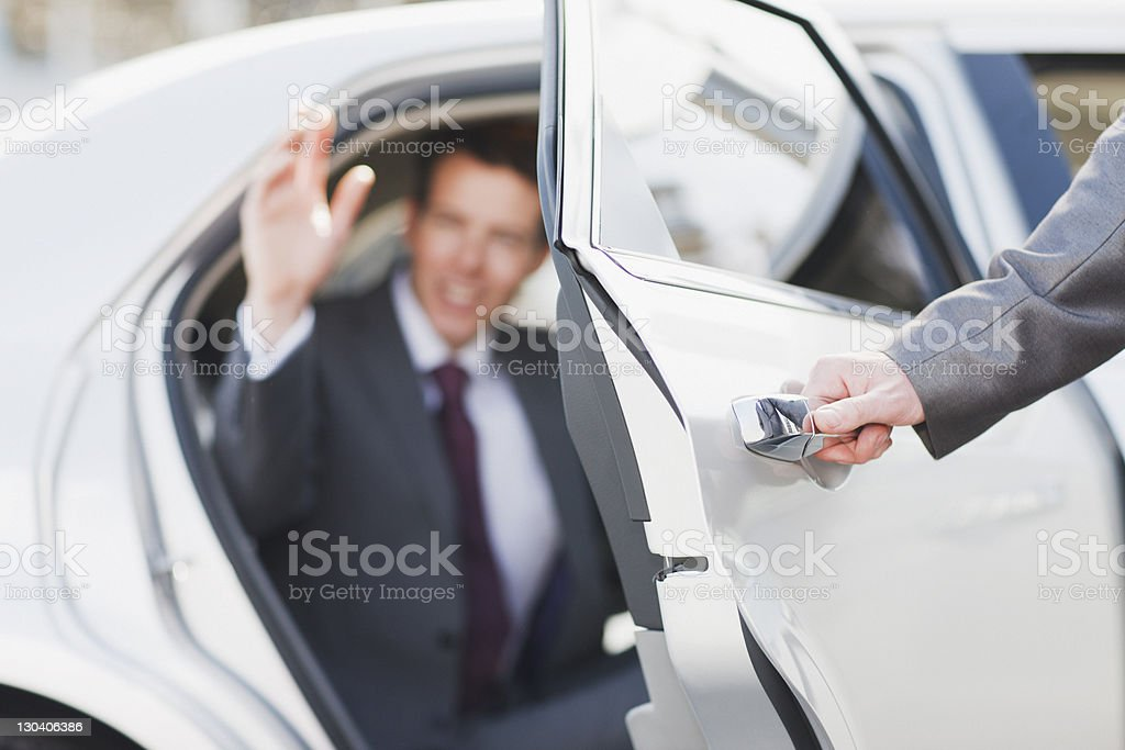 Politician emerging from limo stock photo