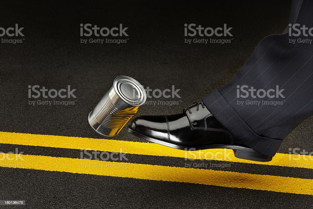 Politician kicking can down the road stock photo