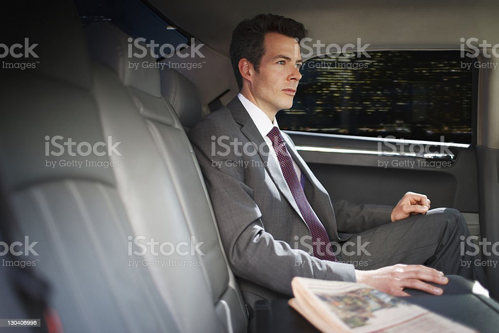 Politician sitting in backseat of car royalty-free stock photo