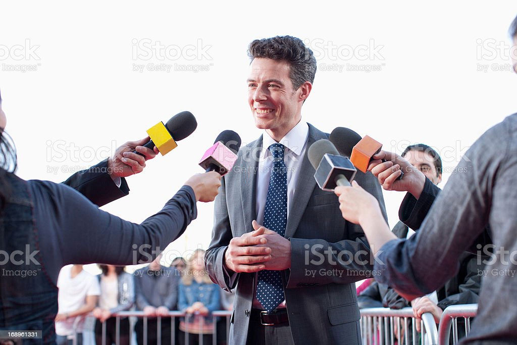 Politician speaking to reporters royalty-free stock photo