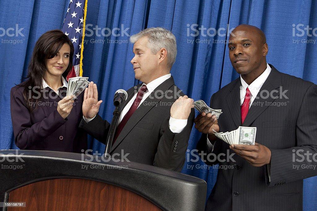 Politician takes a backdoor bribe royalty-free stock photo