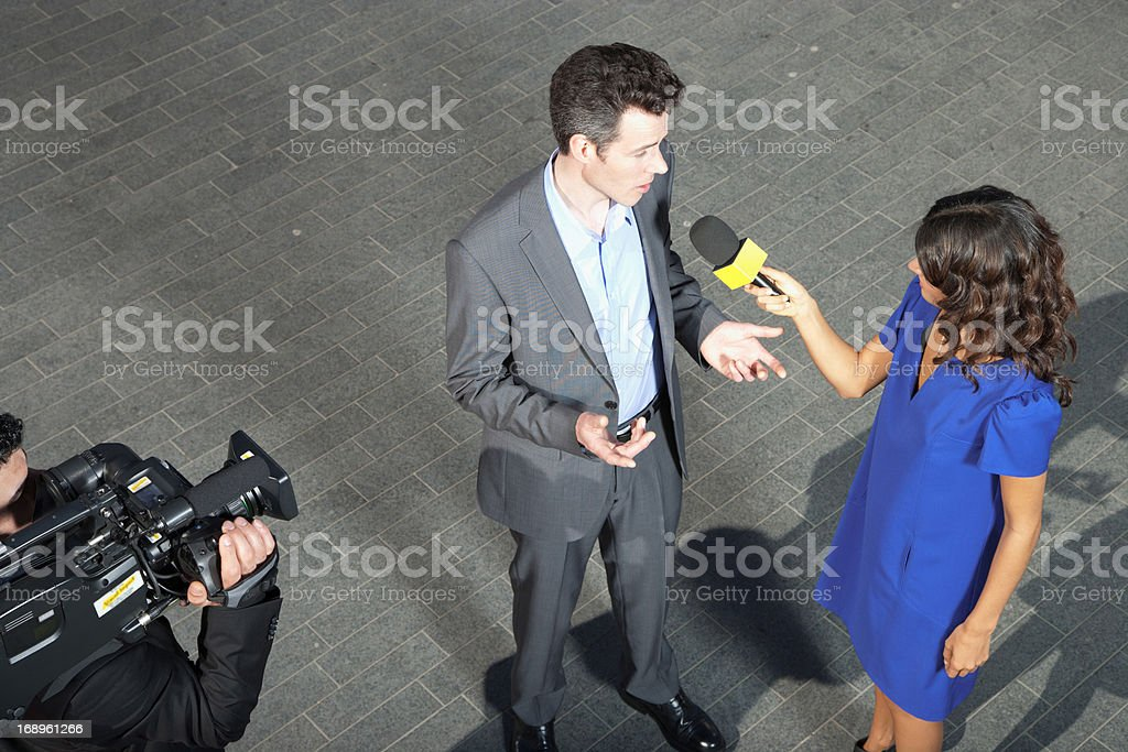 Politician talking into reporters' microphones royalty-free stock photo