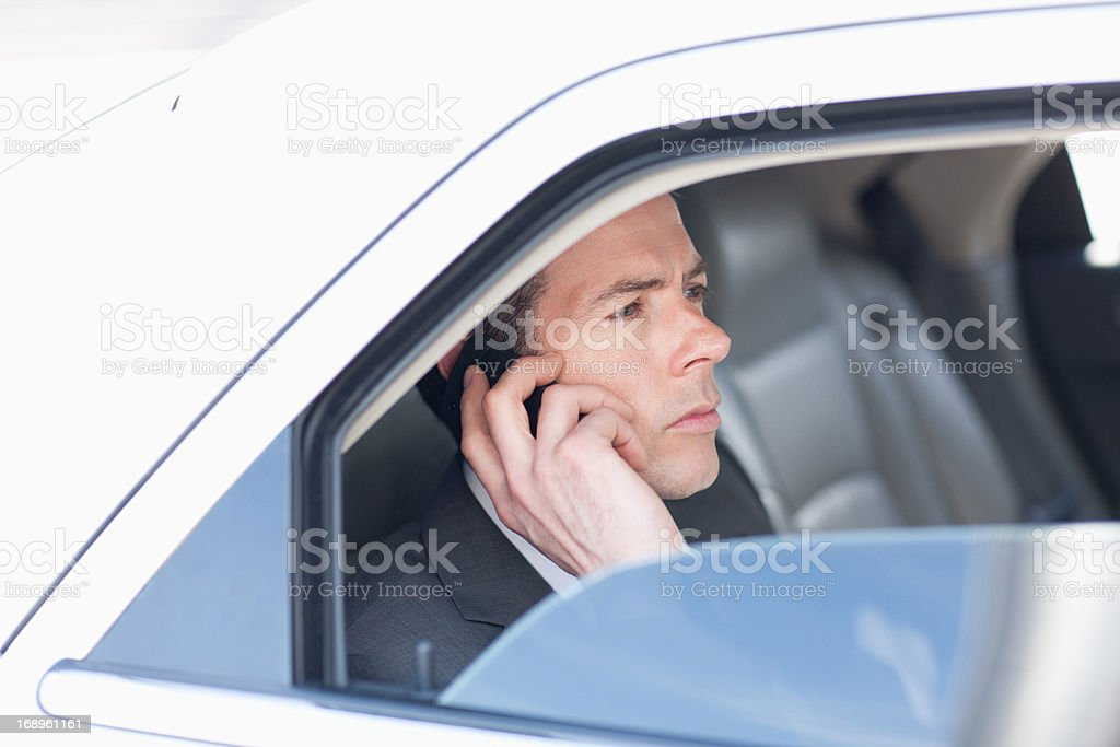 Politician talking on cell phone in backseat royalty-free stock photo