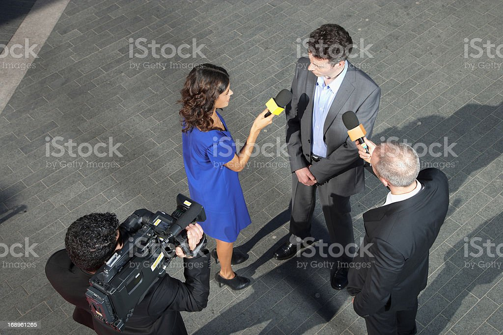 Politician talking to reporters stock photo