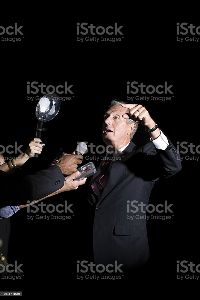 A politician talking to reporters royalty-free 스톡 사진