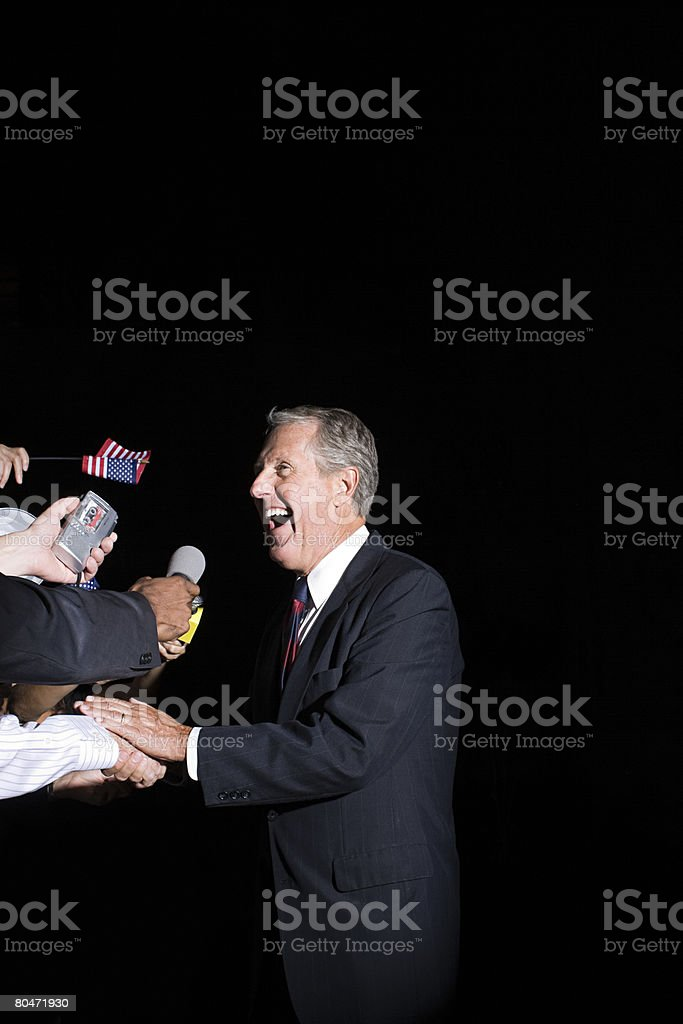 A politician talking to reporters 免版稅 stock photo