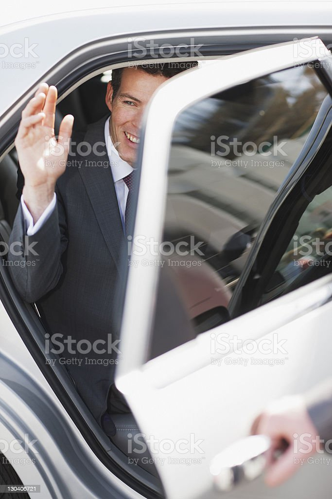 Politician waving and emerging from car royalty-free stock photo