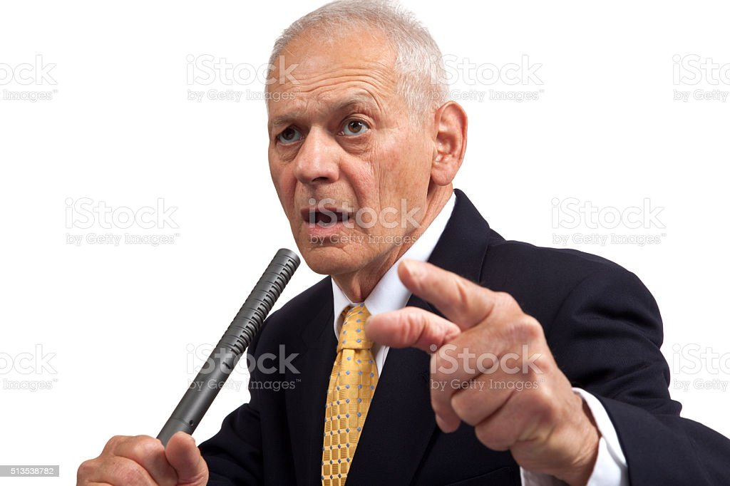 Politician's warning, holding microphone pointing to camera stock photo