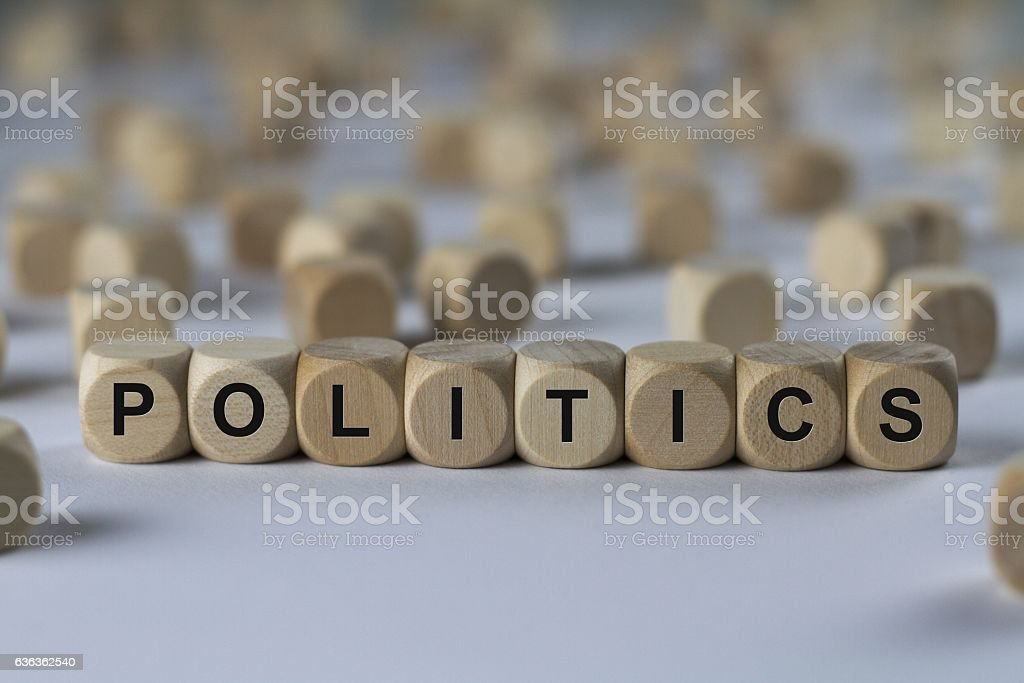 politics - cube with letters, sign with wooden cubes stock photo
