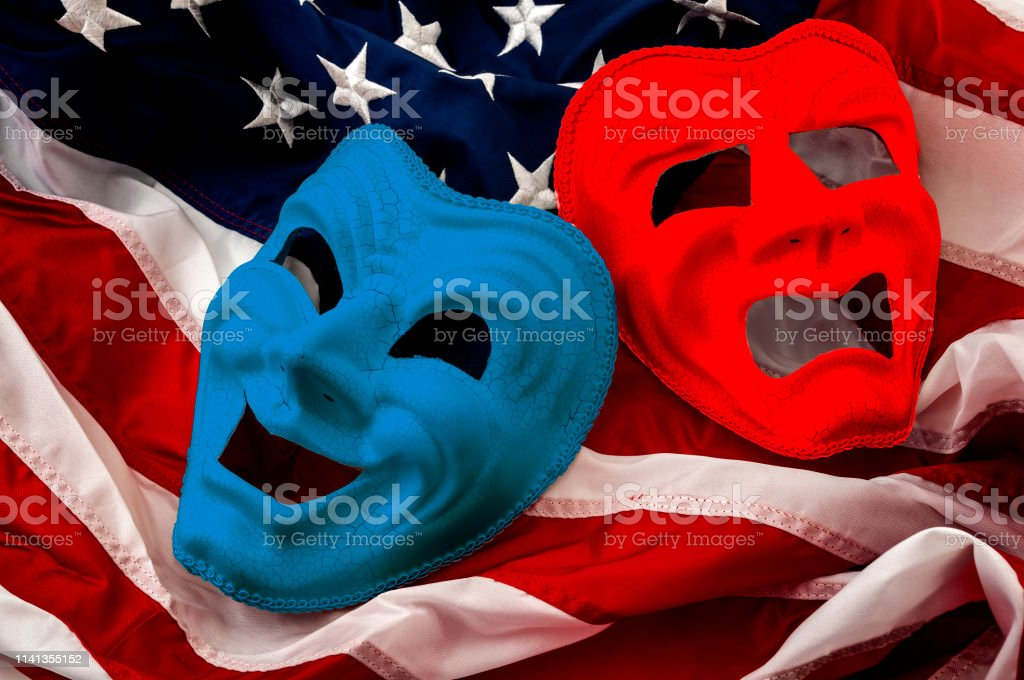 Politics is just a theater, partisan politicians and hyper partisanship concept theme  with comedy and tragedy masks on the American flag stock photo