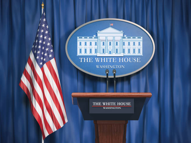 Politics of White House and President of USA United states concept.  Podium speaker tribune with USA flags and sign of White House stock photo
