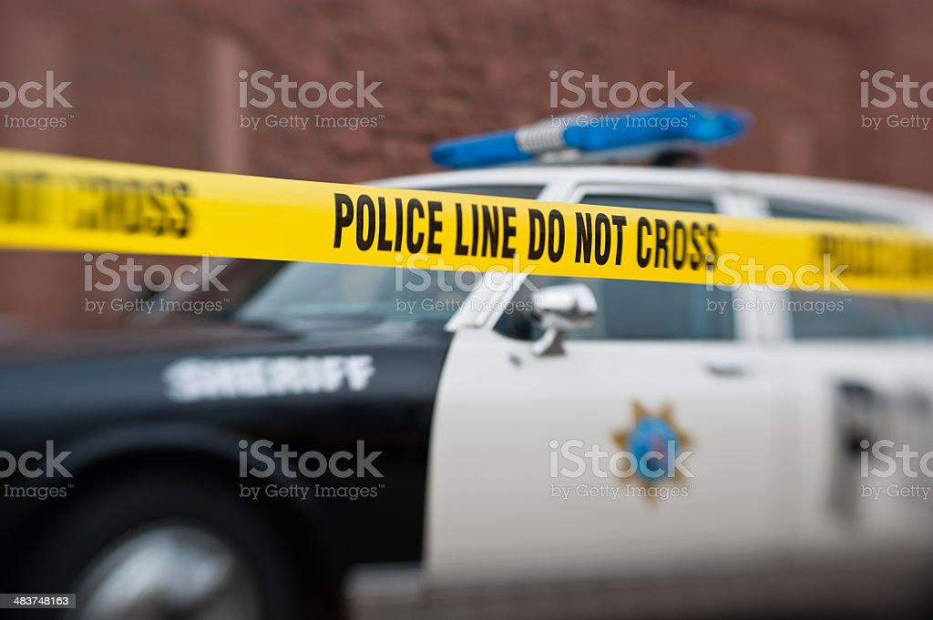 Polizeiauto mit Absperrband / Police car with warning tape stock photo