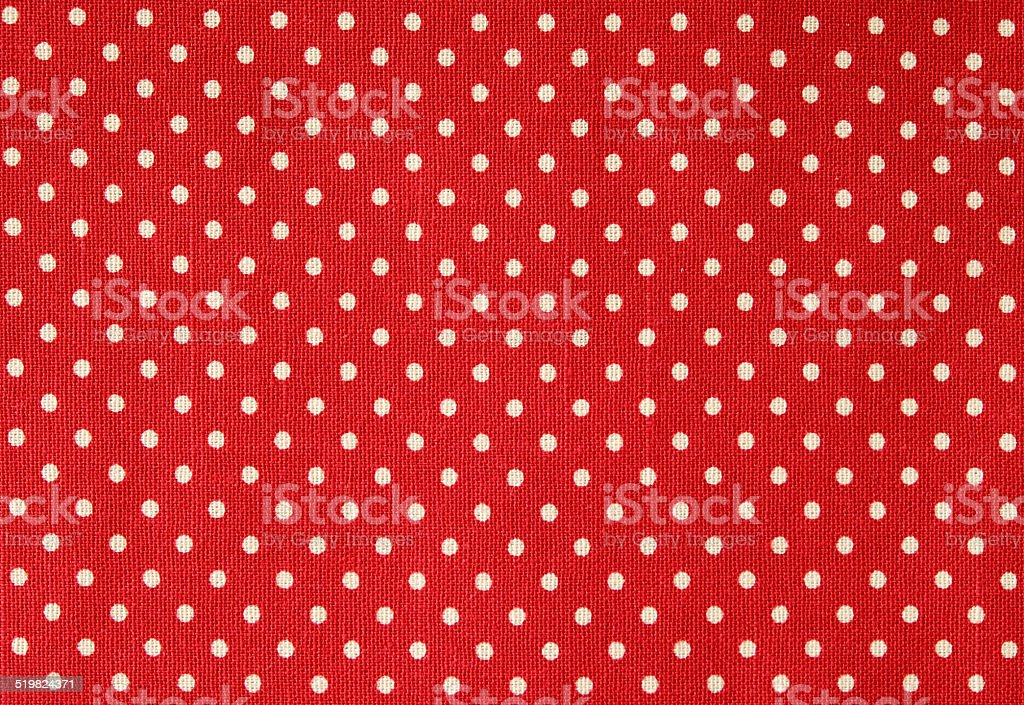 Polka dot on red canvas cotton texture stock photo