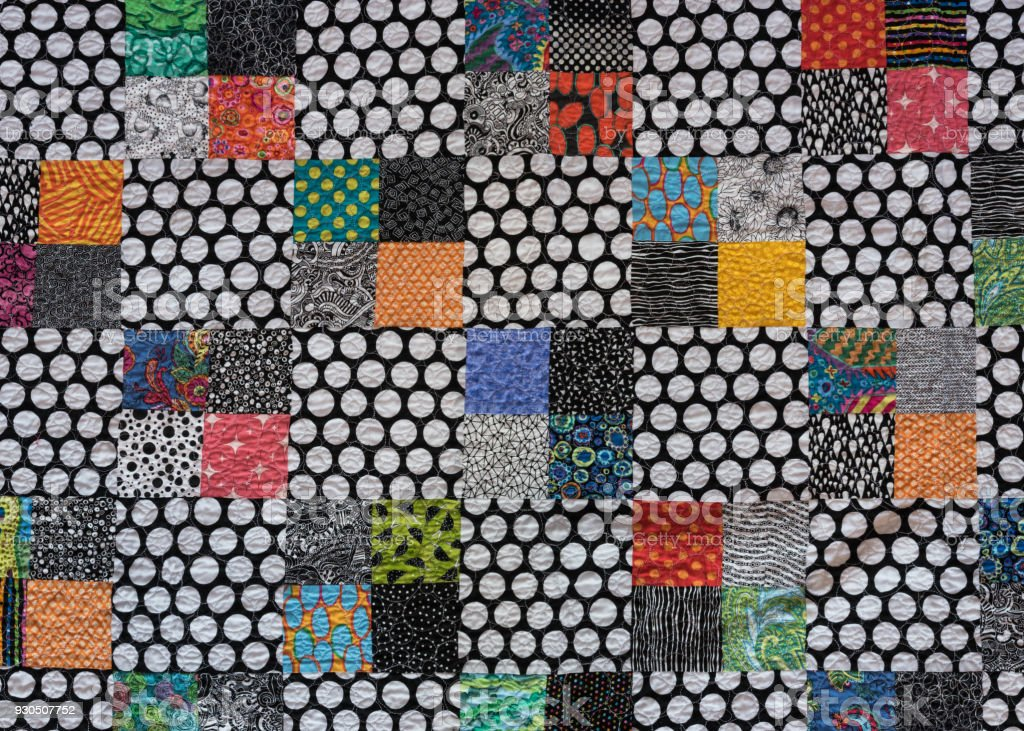 Polka Dot Quilt with Colorful Accents stock photo