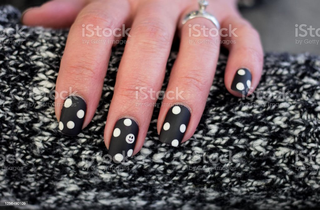 Polka Dot Smiley Face Nail Art Design Stock Photo Download Image Now Istock For those who would like to have fun, interestingly designed nails, this video shows how to paint smiley face nails. polka dot smiley face nail art design stock photo download image now istock