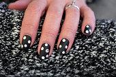 istock Polka Dot Smiley Face Nail Art Design 1256490109