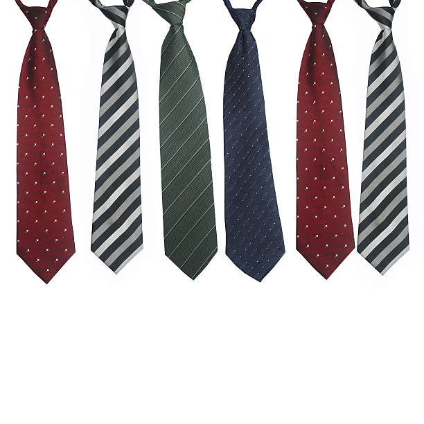 Polka dot ties and chevron ties in red, blue and green stock photo