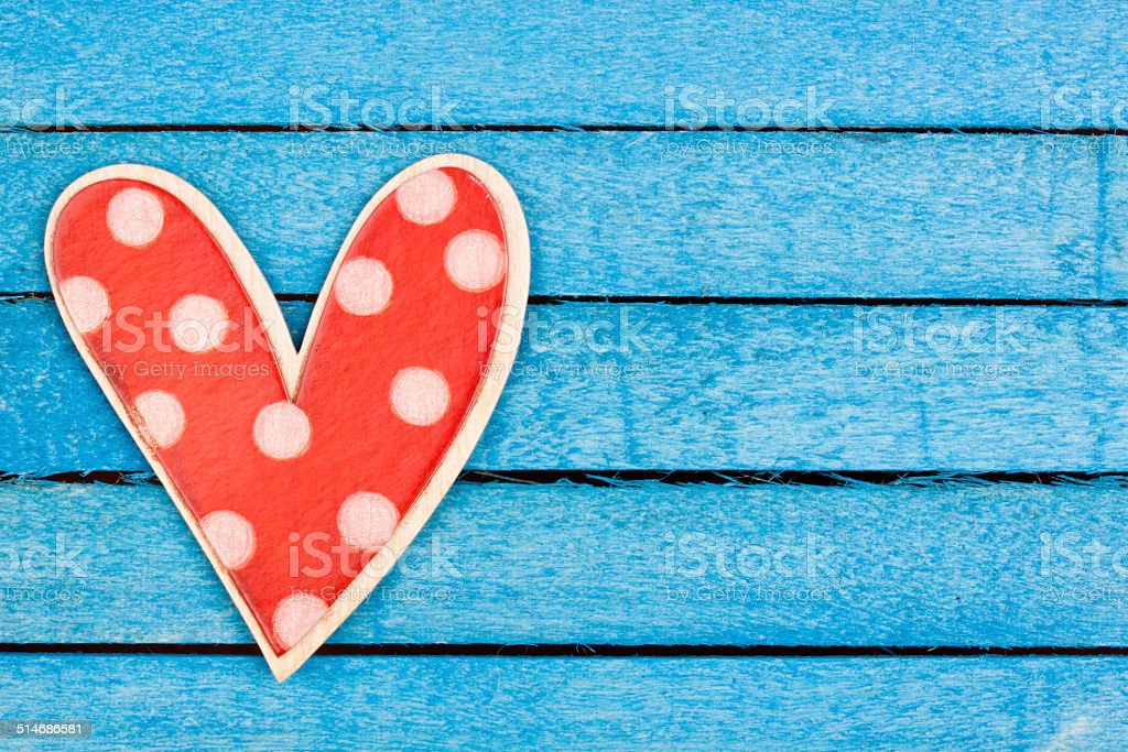 polka dot wooden heart shape stock photo