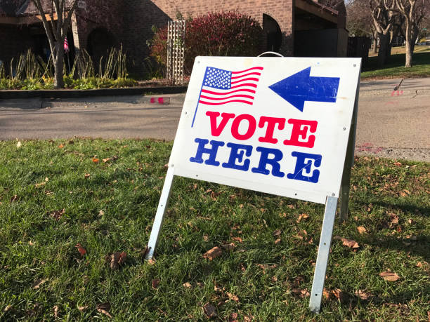 polling place for voting in united states - vote sign stock photos and pictures